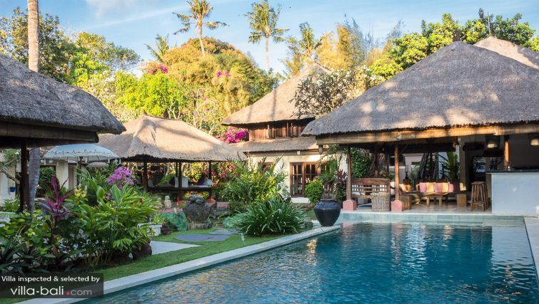 Tropical landscaped gardens with thatched roofed pavilions
