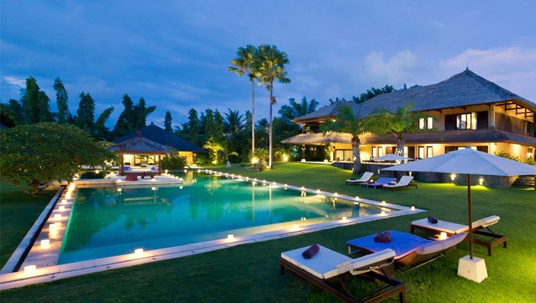 Sprawling grass, pool of luxury villa at Chalina Estate