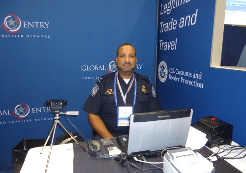 Juan Rivera, an officer with the U.S. Customs and Border Protection (CBP), prepares to help delegates who wish to do so register with the agency's Global Entry program.