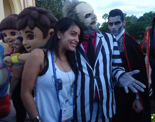 Jimena Villavincenencio Farfán, editor of Vamos!, a Peruvian trade publication, gets close to one of Universal's most popular movie characters of the quarter century—Beetlejuice—at the big event.