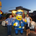 Gretchen Paxton (left) Chief Wiggum and Egidia Contreras Thomas, international sales managers for Enterprise Holdings (Alamo, Enterprise and National car rentals) seem unable to persuade Chief Wiggum, police chief in the Simpsons' Springfield to share his favorite Lard Lad donut shop donuts