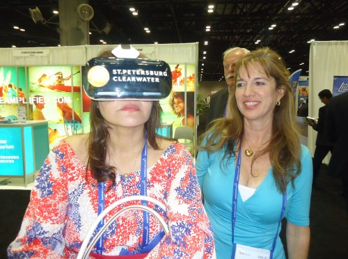 The Oculus Rift virtual reality headset created so much buzz about the ipw exhibit floor, that the staff for the Visit St. Pete/Clearwater staff who showed the devices to visitors, said Frances Trabal, deputy direct (on the right) ran out of business cards, which mean that interested parties had to take smartphone photos of their cards. Also, the batteries on the devices got so much work that they died by mid-afternoon today.