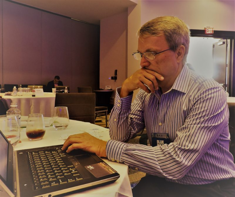 Like most delegates to International Digital Day, Jim McMichael, specialty markets manager for the Las Vegas Convention and Visitors Authority, works at his laptop during breaks.