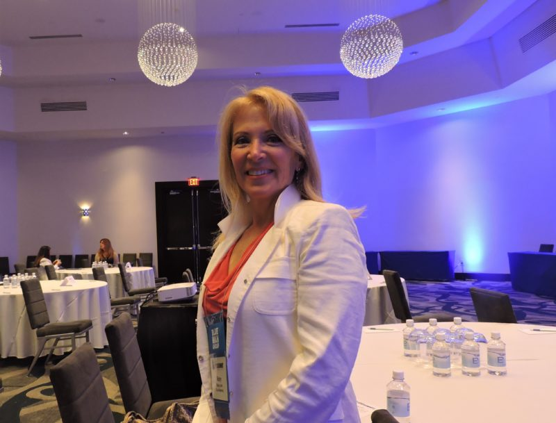 Robyn Levin, CEO of R. Levin Marketing, sets up for her presentation on using YouTube and Facebook videos to market to international audiences.