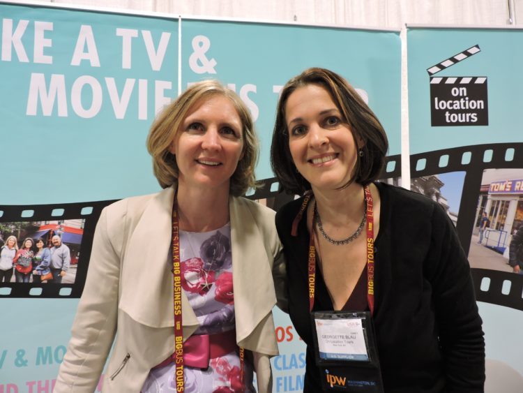 At the booth of On Location Tours: Georgette Blau (right), president; and Rebecca George, trade sales manager, Australia/New Zealand.
