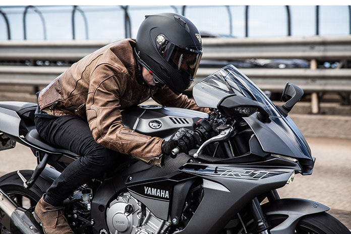 A man riding with Forcite smart motorcycle helmet