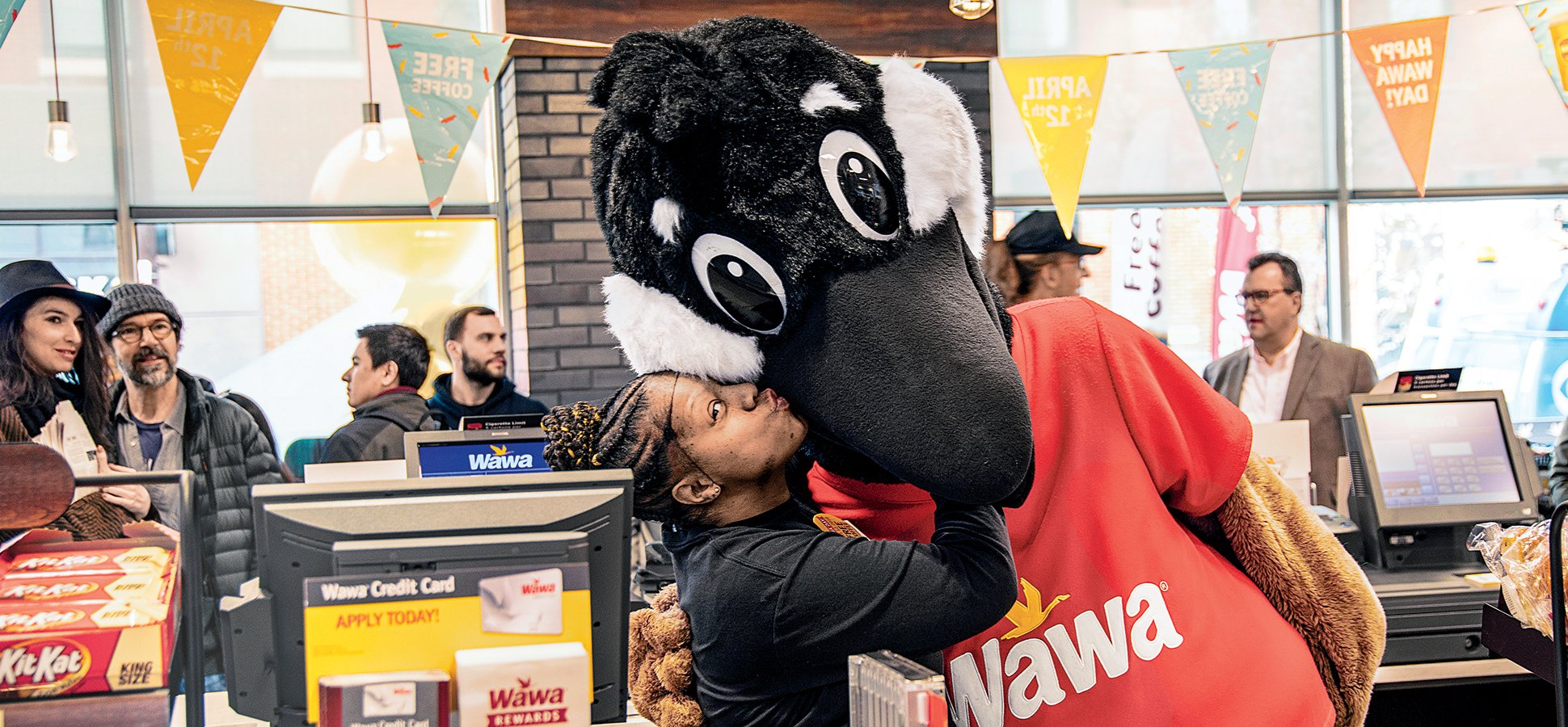 How Wawa Became the Beloved  10 Billion King of Convenience Stores     Wawa employee Towanda Davis and the company mascot  Wally Goose  wawa is the  Ojibwe word for a Canadian goose   feeling the love at the opening of a  Wawa