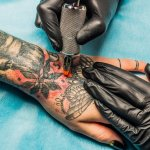 Do Your Tattoos Mean You Won't Get Hired? Studies Say Yes (Unless This Happens)