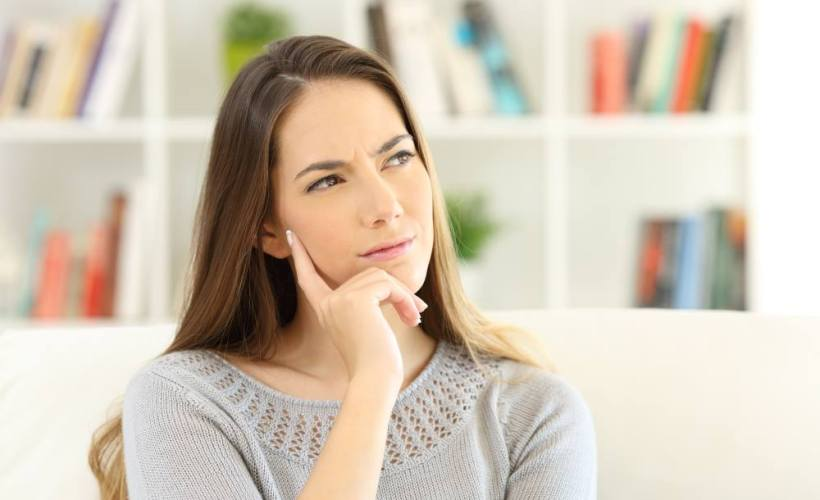 female thinking about macroplastique for stress incontinence