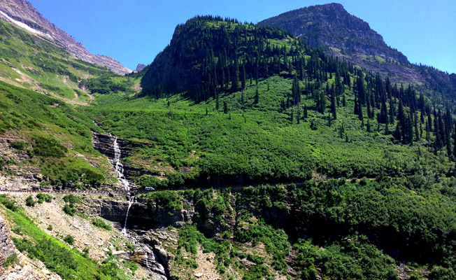 Waterfall dripping off the side of a mountain