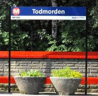 commuter herbs growing at Todmorden train station