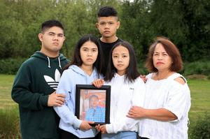 Family tragedy: Mikee Plangca with a photo of her beloved dad with siblings Michael, John and Chekie and their aunt Fely. Photo: Frank McGrath