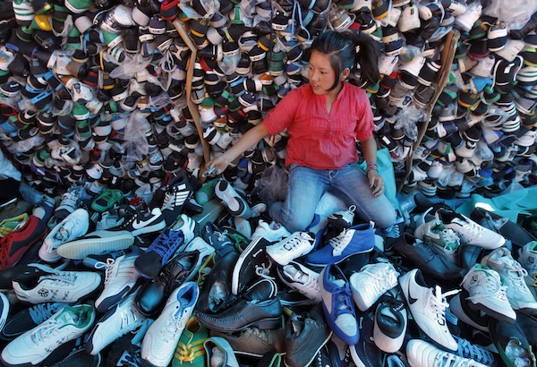 Children stitch shoes for global market in India's tourist magnet