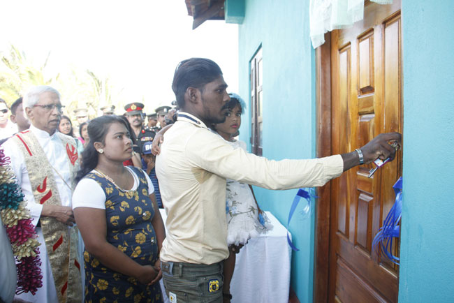 Jaffna security forces build new homes for low-income families