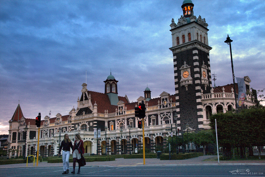 Dunedin's Railway Station with Independent Couple