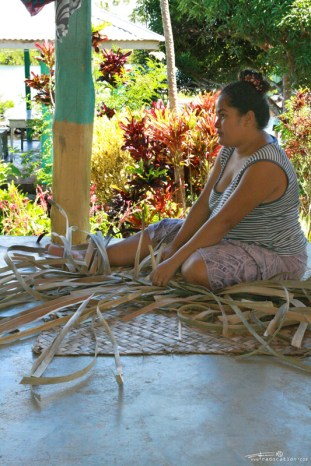 Samoan woman making traditional mats from dried palm leafs. ©Radoslav Cajkovic
