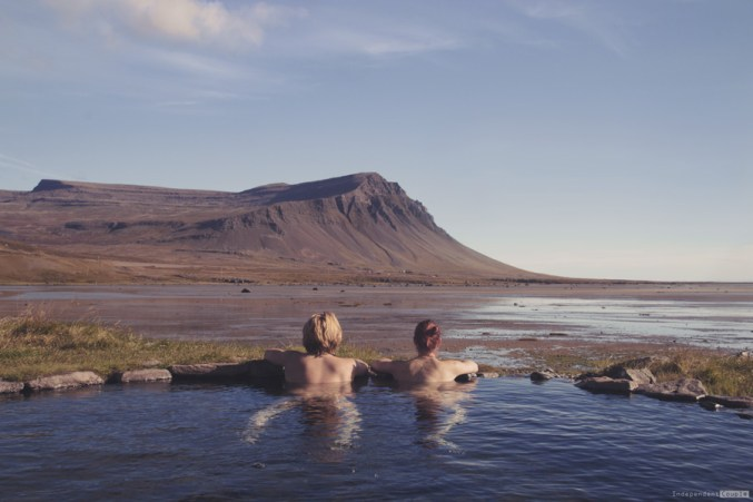 Swimming in the natural hot spring in Westfjords. Iceland travel, hot spring, natural hot spring in Iceland