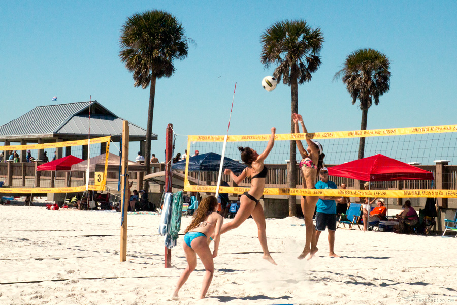 girls are playing beach volleyball on Clearwater Beach