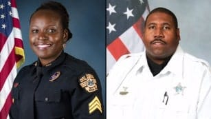 Orlando police Master Sgt. Debra Clayton, 42 and Deputy First Class Norman Lewis are pictured in the photo.