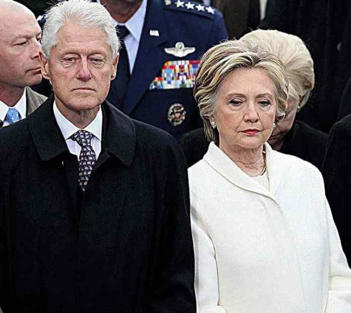 Hillary and Bill enjoying themselves at the inaugural..