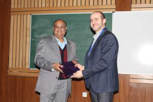 Brejesh Lal presenting a memento to Prof Samir at Developers tutorial in Delhi