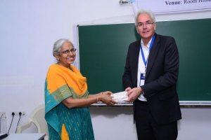 Klaus Pendl presents a memento to Jayanthi Sivaswamy at Developers tutorial in IIIT Hyderabad