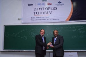 Sachin Chaudhari presents a memento to Prof Laurent at Developers tutorial in IIIT Hyderabad