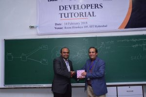Sachin Chaudhari presents a memento to Sachin Gaur at Developers tutorial in IIIT Hyderabad