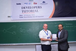 Sachin Chaudhari presents a memento to Thierry at Developers tutorial in IIIT Hyderabad