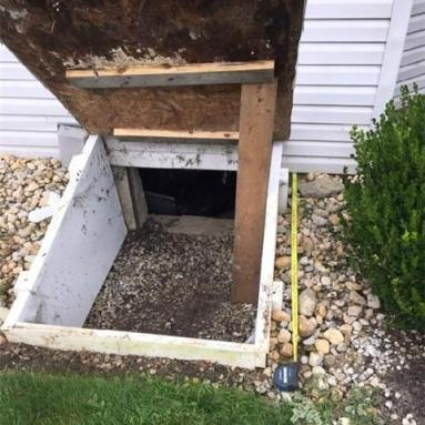 Old access well to crawl space