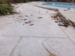 unlevel concrete pool deck before
