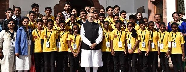 pm-with-a-group-of-underprivileged-students-indian-bureaucracy
