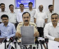 Thane Crime Branch officials show a examination paper of the Army Recruitment Board that was allegedly leaked