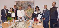 Smriti Irani signing ceremony -Indian Bureaucracy