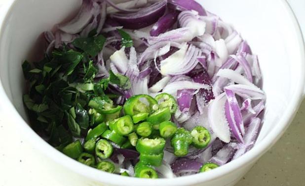 making dough for onion pakoda