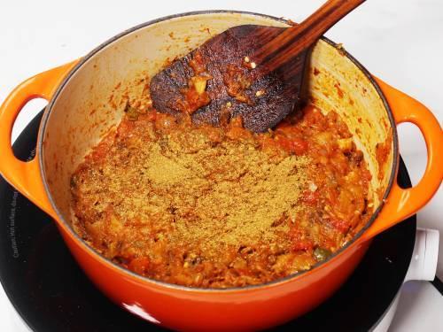 adding garam masala