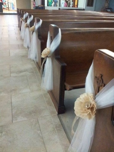 A combination of flowers and fabric to decorate pews - Aisle Decoration Ideas