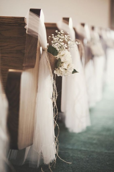 Babybreath bouquets with white fabric tied on pews - Aisle Decoration Ideas
