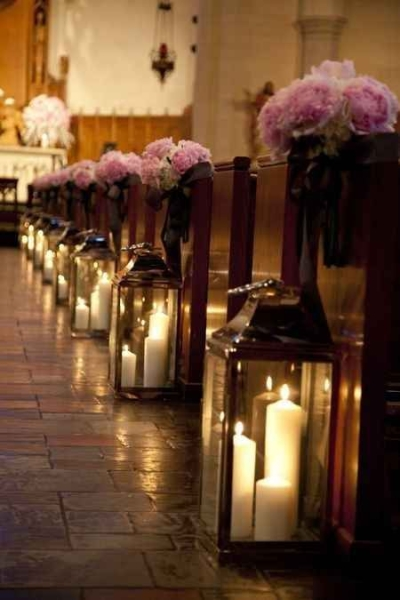 Candles in lanterns and some beautiful flowers - Aisle Decoration Ideas