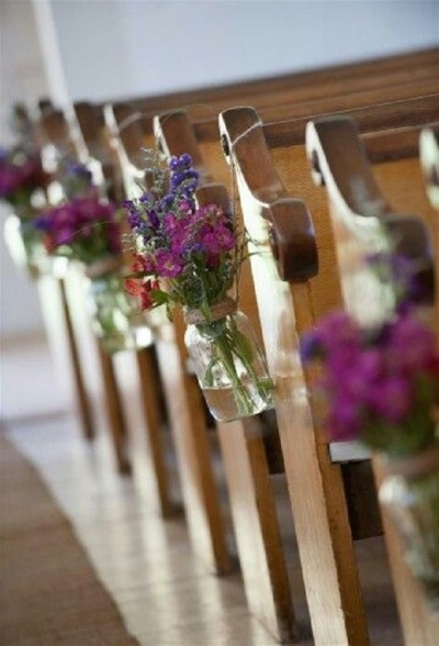 little flowers in the empty jars tied with strings onto the pews - Aisle Decoration Ideas