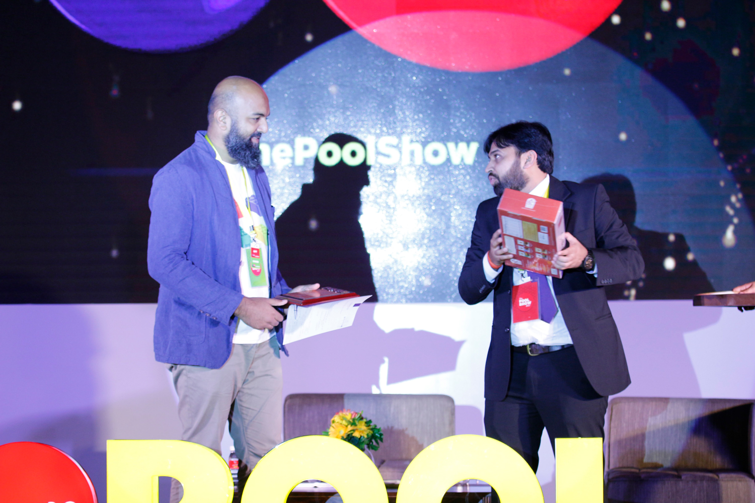 Ayaz Busrai, of Busride Studio, receives a memento from Tarun Thakkar, Marketing head at POOL Magazine.