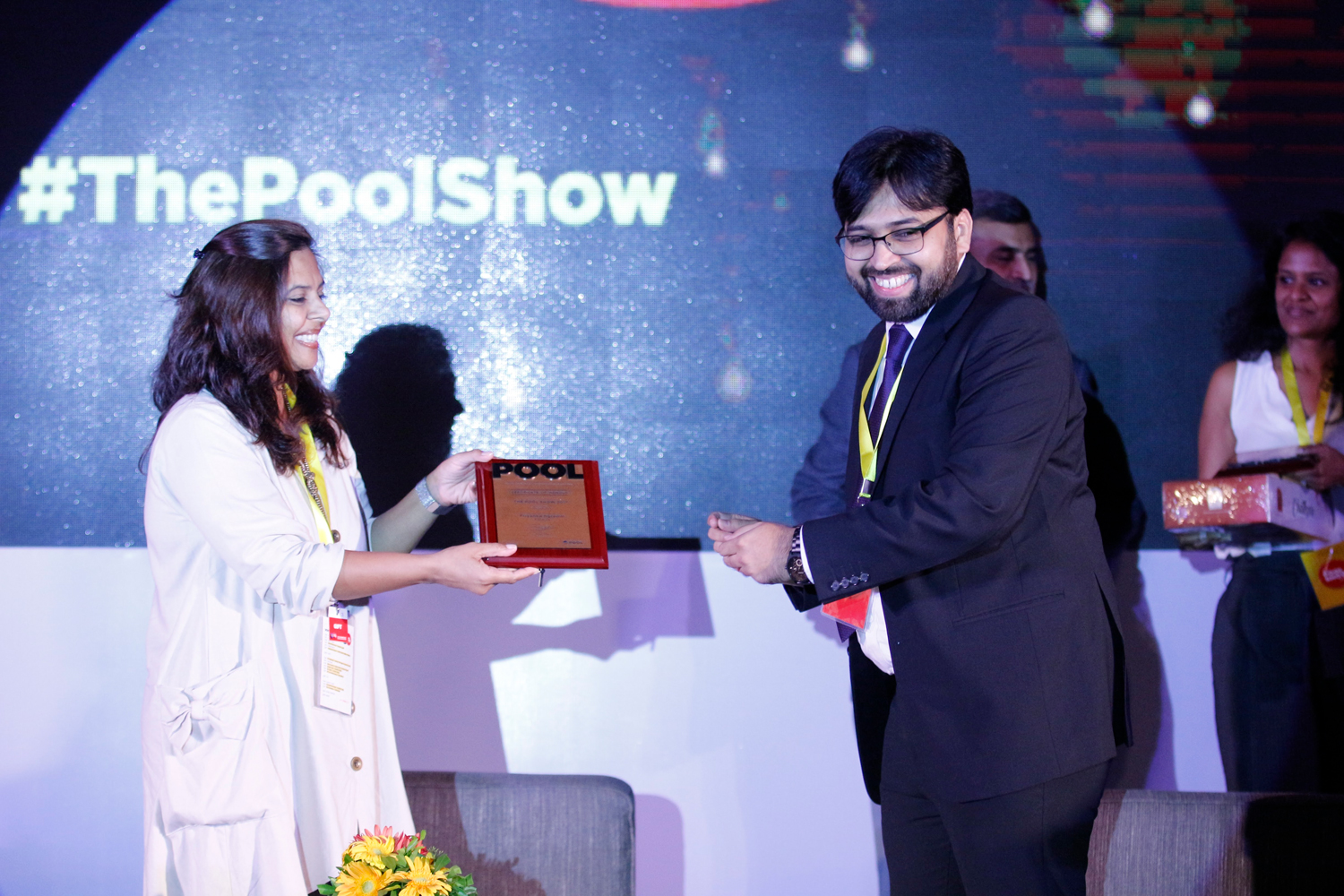 Raman Saxena, Geetha Suthar and Priyanka Agarwal, receive mementos from Tarun Thakkar, head of Marketing at POOL Magazine.