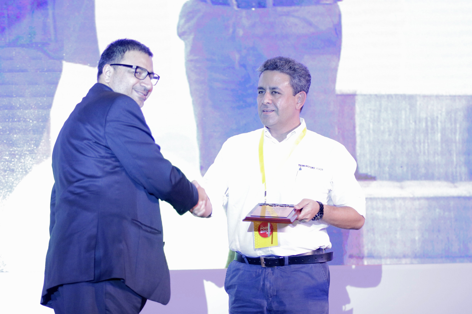 Ajay Sharma, receives a memento from Sudhir Sharma, Founder and Editor-in-chief of POOL Magazine.