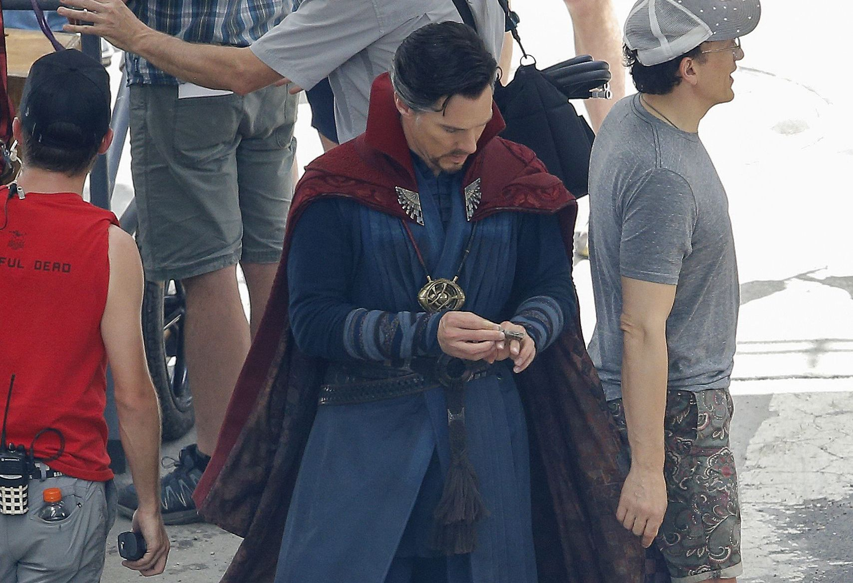 """Cast member Benedict Cumberbatch, in red cape, walks to the set during the filming of """"Avengers: Infinity War, in Atlanta. The set is modeled after a New York City streetAvengers Infinity War, Atlanta, USA - 28 Jun 2017"""