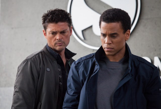 No Merchandising. Editorial Use Only. No Book Cover Usage. Mandatory Credit: Photo by Frequency/Bad Robot/Warner B/REX/Shutterstock (5884962z) Karl Urban, Michael Ealy Almost Human - 2013 Frequency Films/Bad Robot/Warner Bros. TV USA Television Scifi