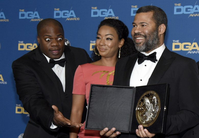 "Marcus Henderson, Betty Gabriel, Jordan Peele. Marcus Henderson, from left, and Betty Gabriel pose with Jordan Peele and his medallion honoring a nomination for outstanding directorial achievement in a feature film for ""Get Out"" at the 70th annual Directors Guild of America Awards at The Beverly Hilton hotel, in Beverly Hills, Calif70th Annual DGA Awards - Press Room, Beverly Hills, USA - 03 Feb 2018"