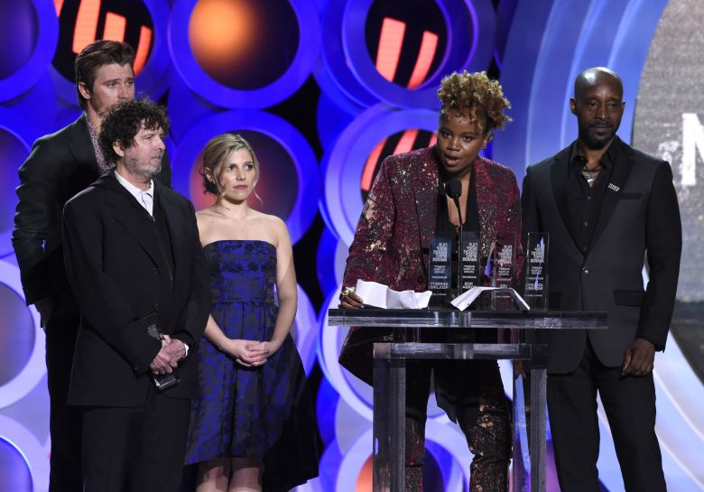 """Dee Rees, Garrett Hedlund, Billy Hopkins, Ashley Ingram, Rob Morgan. Dee Rees, second from right, accepts the Robert Altman award for """"Mudbound"""" at the 33rd Film Independent Spirit Awards, in Santa Monica, Calif. Looking on from far left are Garrett Hedlund, Billy Hopkins, Ashley Ingram and Rob Morgan2018 Film Independent Spirit Awards - Show, Santa Monica, USA - 03 Mar 2018"""