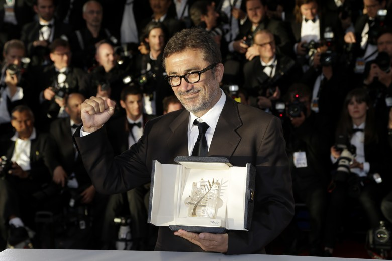 Director Nuri Bilge Ceylan poses with the Palme d'Or award for the film Winter Sleep during a photo call following the awards ceremony at the 67th international film festival, Cannes, southern France France Cannes Awards Photo Call, Cannes, France