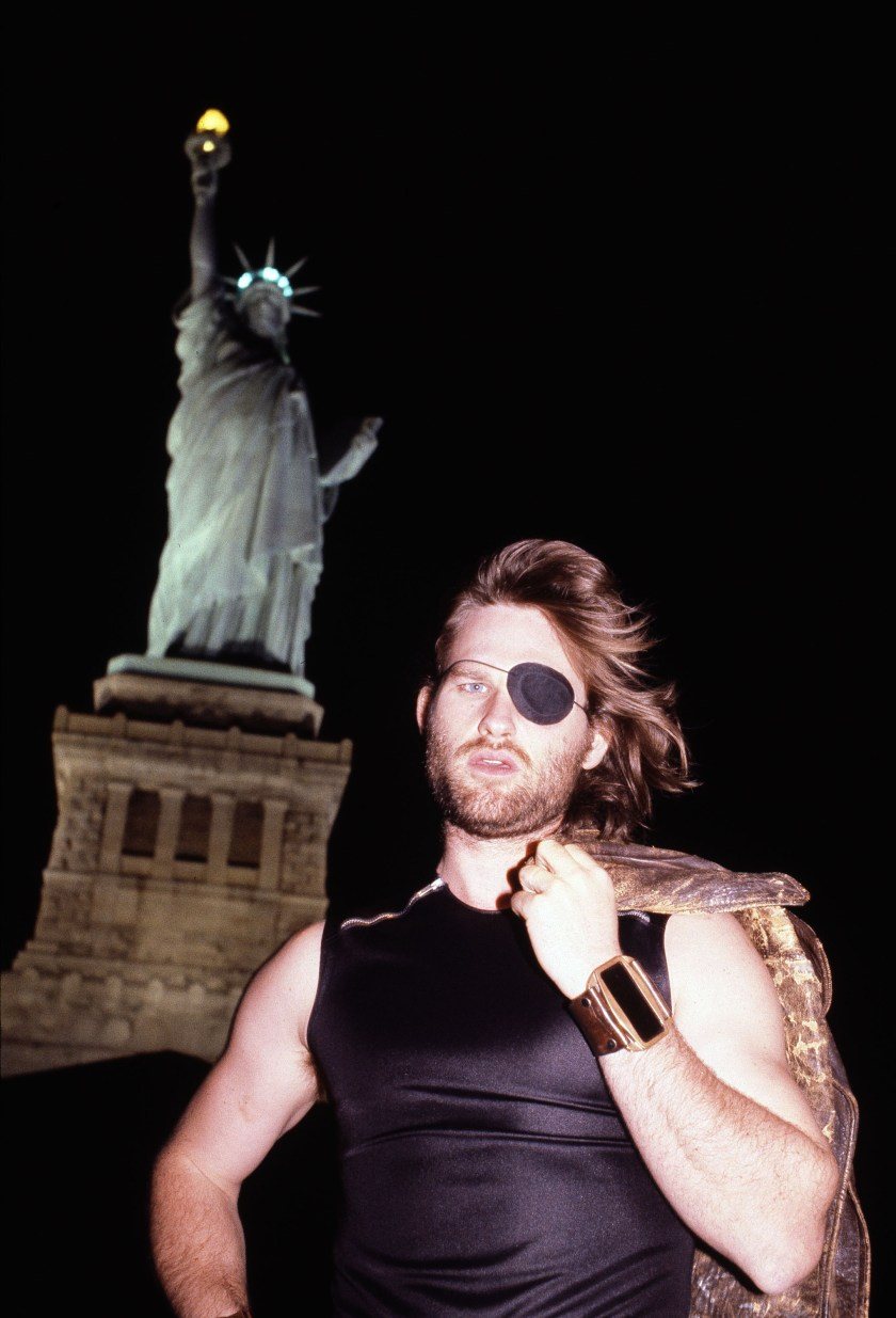 "Russell Actor Kurt Russell, who stars in the movie ""Escape From New York,"" is seen near the Statue of Liberty during filmingRussell Escape From New York 1980, New York, USA"