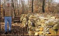 Tom Hendrix walks along a section of a rock wall he built as a memorial to his great-great-grandmother, a Yuchi Indian who was driven from Lauderdale County to Oklahoma on the Trail of Tears. DANIEL GILES/TimesDaily